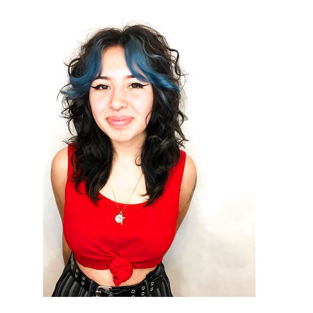 Dark Layered Lob with Undone Curly Texture and Blue Curtain Bangs Medium Length Hairstyle
