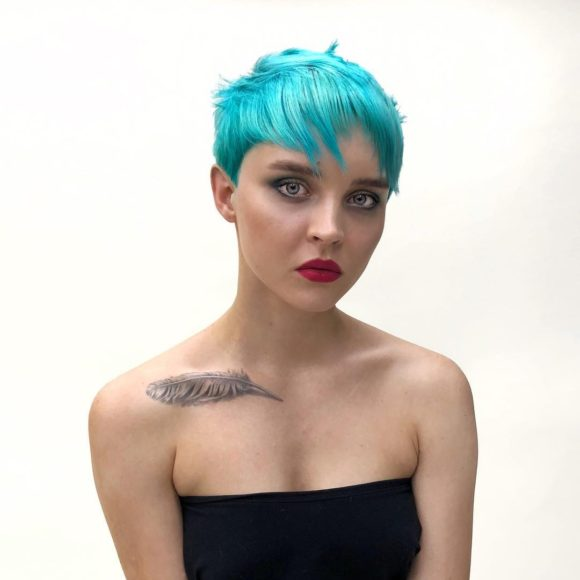 Eccentric Choppy Pixie with Messy Texture and Bright Turquoise Blue Hair Color Short Fall Hairstyle