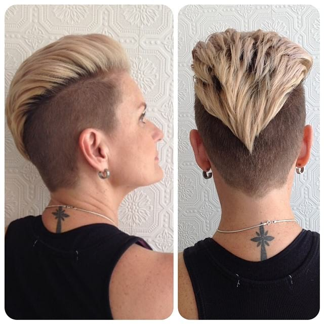 Edgy Blonde Undercut with Voluminous Brushed Back Texture and Shadow Roots Short Hairstyle