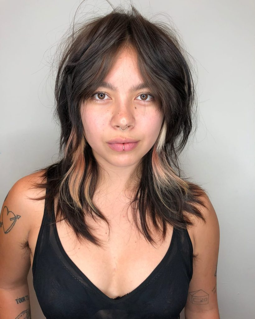 Edgy Brunette Curtain Banged Shag with Messy Natural Texture and Pink and Blonde Peek-a-Boo Highlights Medium Length Summer Hairstyle