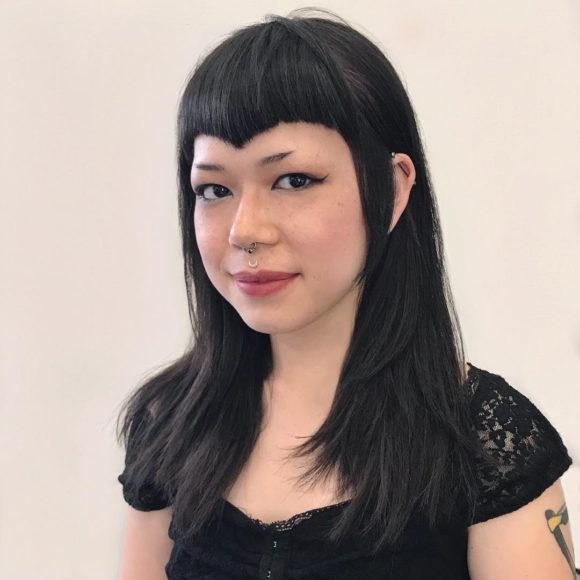 Edgy Face Framing Layered Cut with Curved V Shaped Bangs and Black Hair Color Medium Length Fall Hairstyle