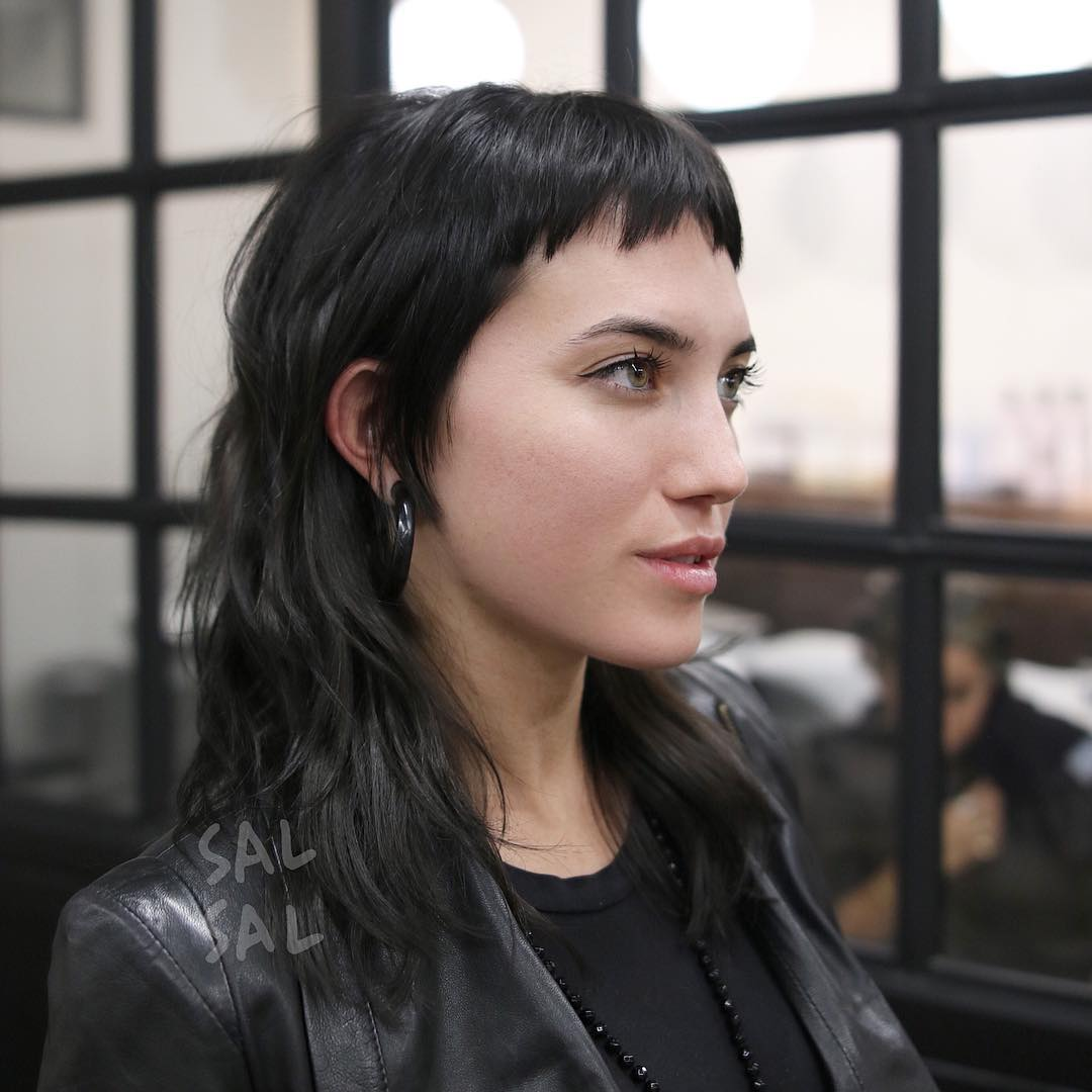 Edgy Modern Textured Mullet with Choppy Micro Bangs and Black Color Medium Length Hairstyle
