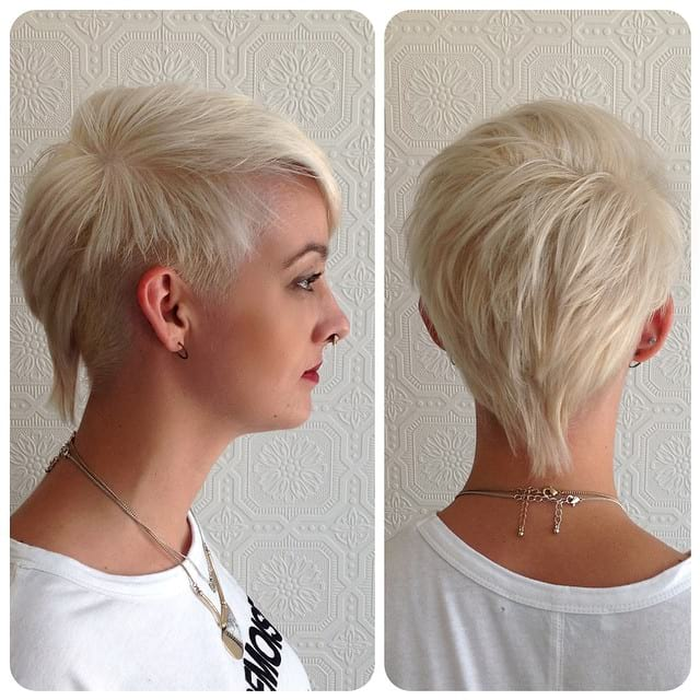 Edgy Platinum Textured Mullet with Tapered Sides and Side Swept Bangs Short Hairstyle