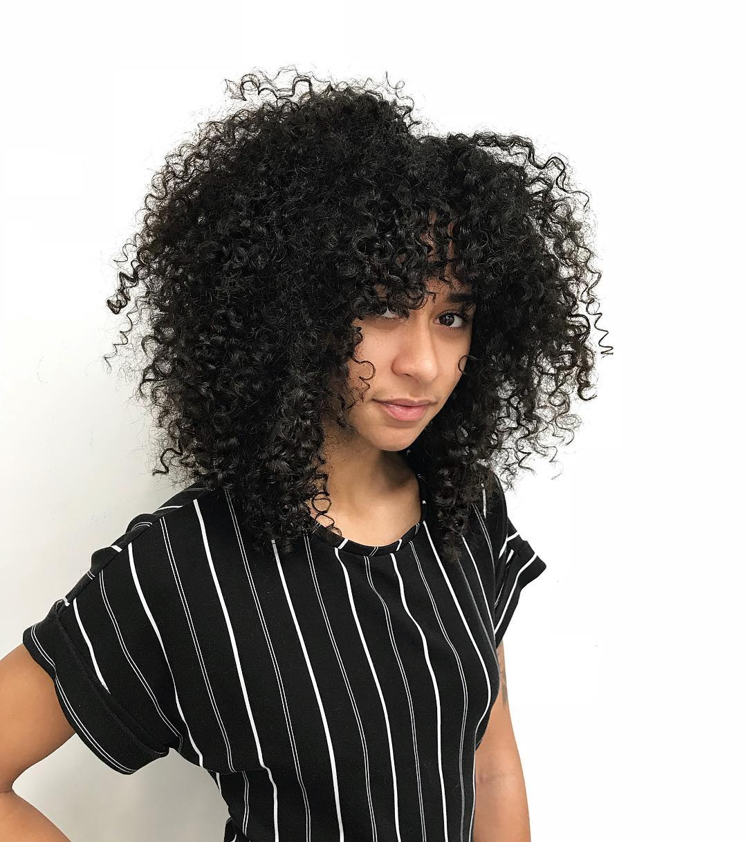 Face Framing Fringe Cut with Natural Curly Texture and Volume on Black Hair Long Trendy Afro Hairstyle