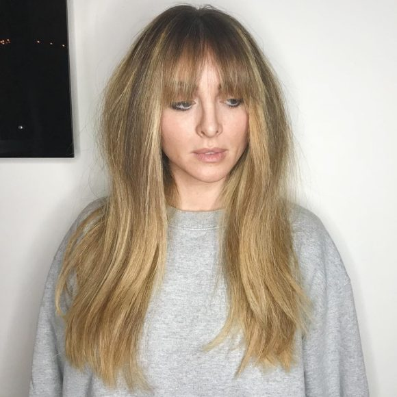 Golden Blonde Layered Cut with Fringe Bangs and Highlights Long Hairstyle