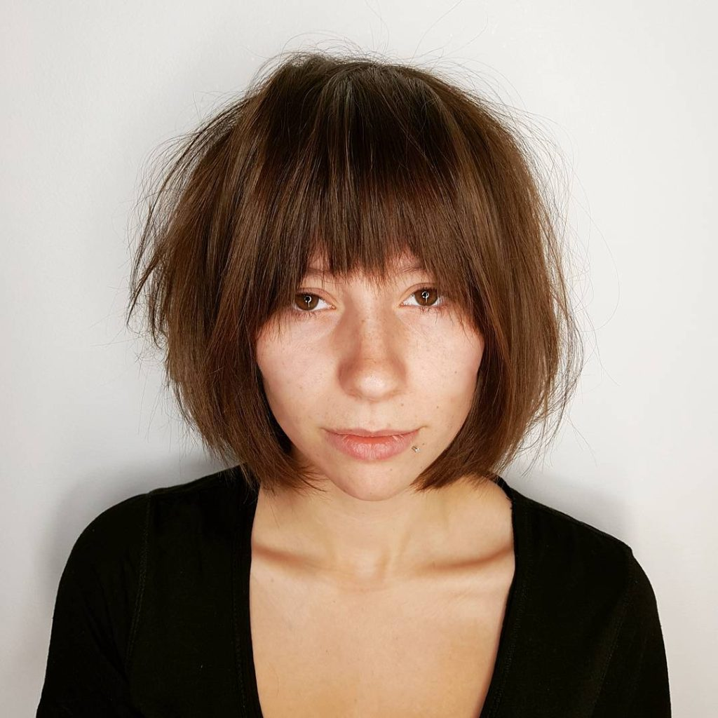 Golden Brown Shaggy Bob with Straight Undone Texture and Fringe Bangs Medium Length Hairstyle