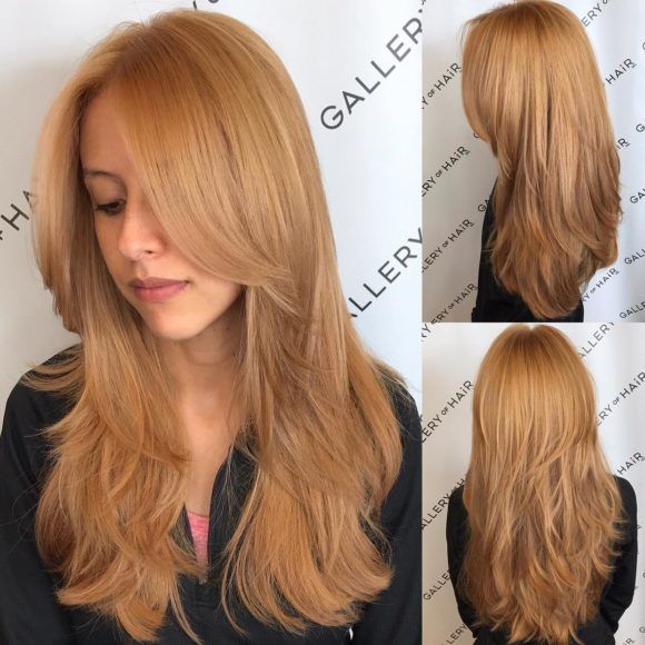 Golden Strawberry Blonde Shaggy Layered Cut with Center Part Long Hairstyle
