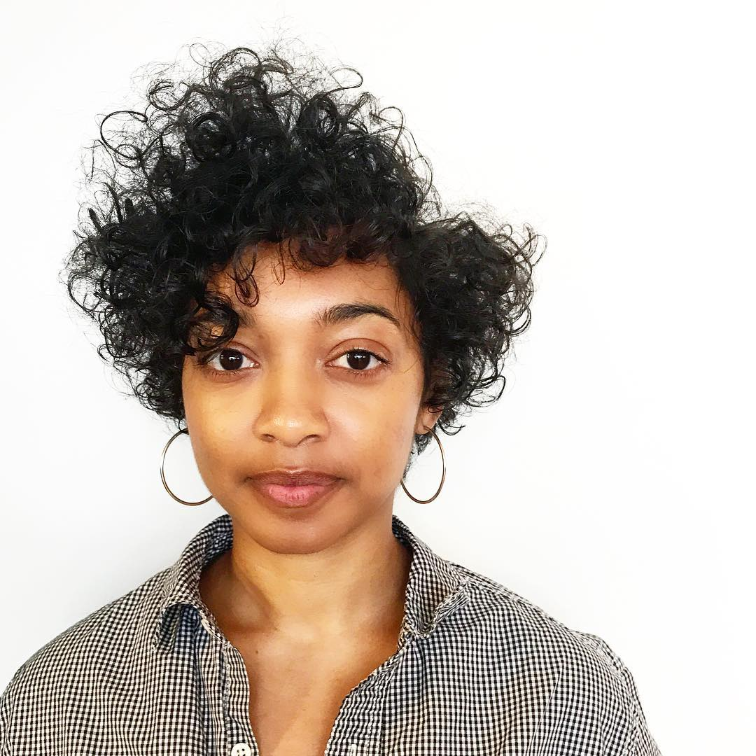 Graduated Bias Cut with Disconnected Side Part and Spiral Curls Short Hairstyle