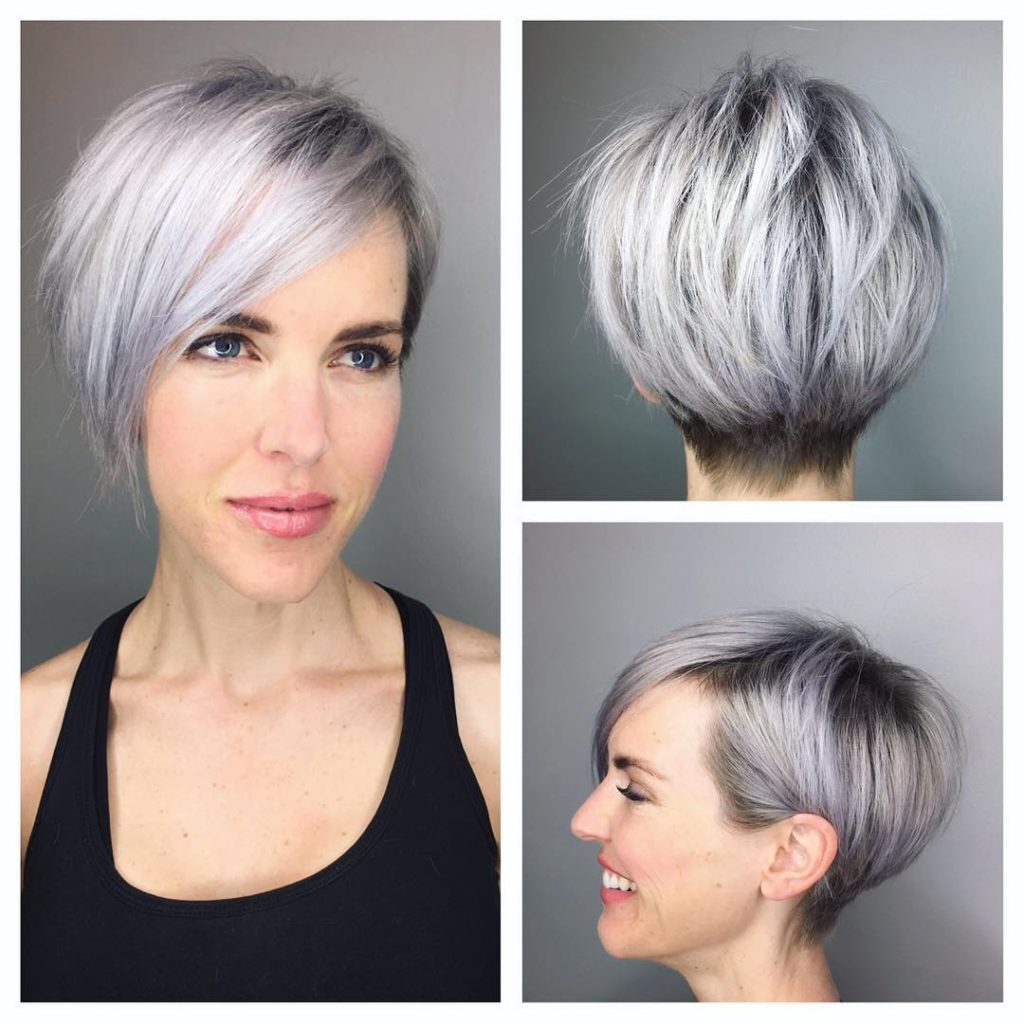 Graduated Silver Textured Pixie with Side Swept Bangs and Shadow Roots Short Hairstyle