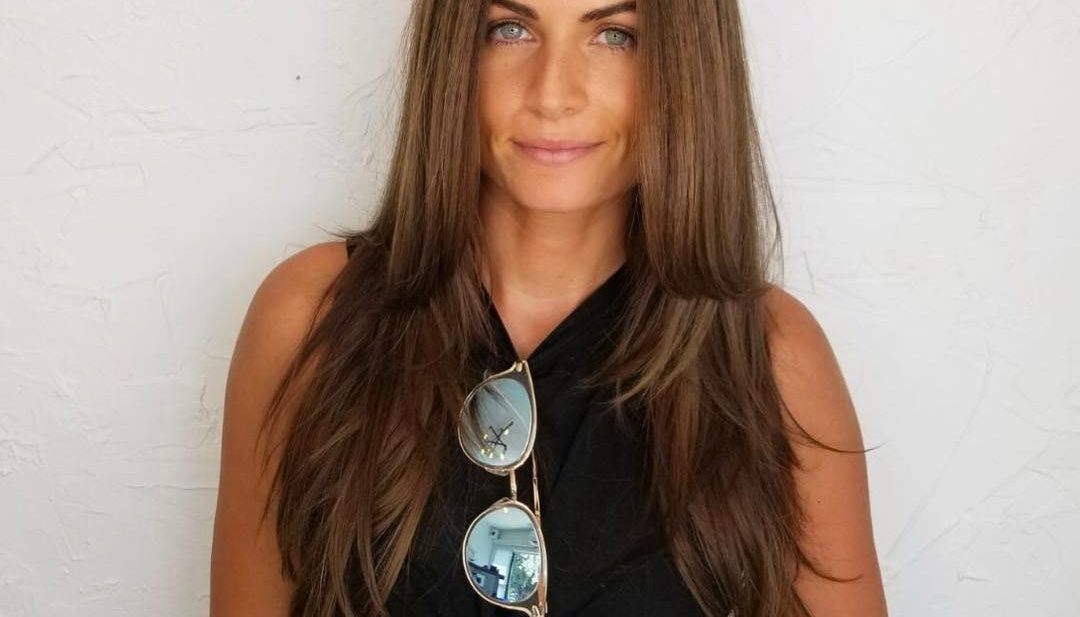 Layered Cut with Straight Wind Blown Beachy Texture and Deep Bronzed Brown Hair Color Long Summer Hairstyle