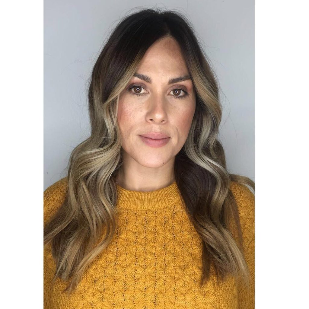 Subtle Layered Cut with Bombshell Wavy Texture and Light Brown Balayage Color Medium to Long Chic Polished Fall Hairstyle