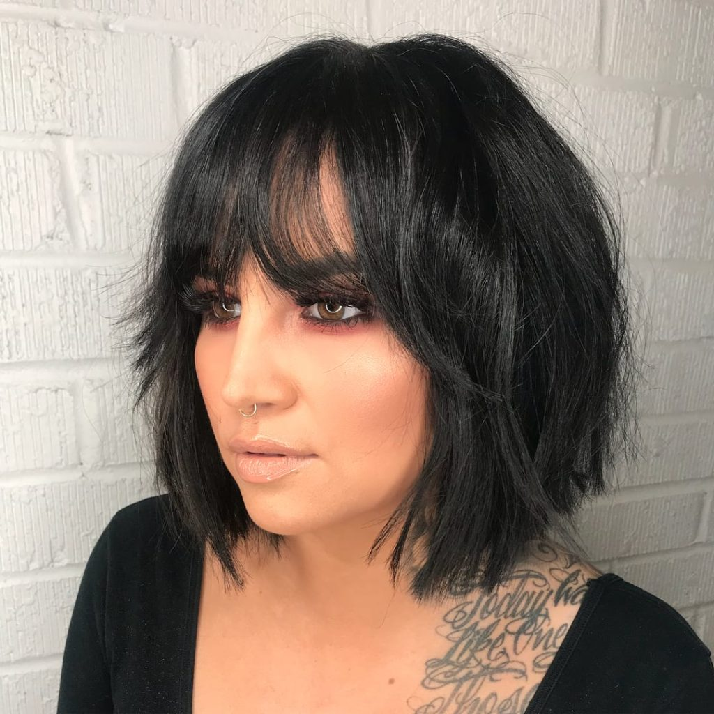 Layered Modern French Bob with Face Framing Fringe Bangs and Messy Just a Bend Texture on Black Hair Medium Length Summer Hairstyle