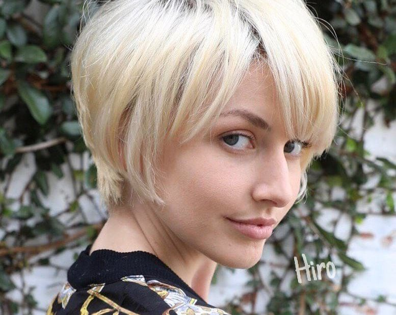 Layered Platinum Blonde Pixie with Messy Textured Fringe and Side Swept Bangs Short Summer Hairstyle