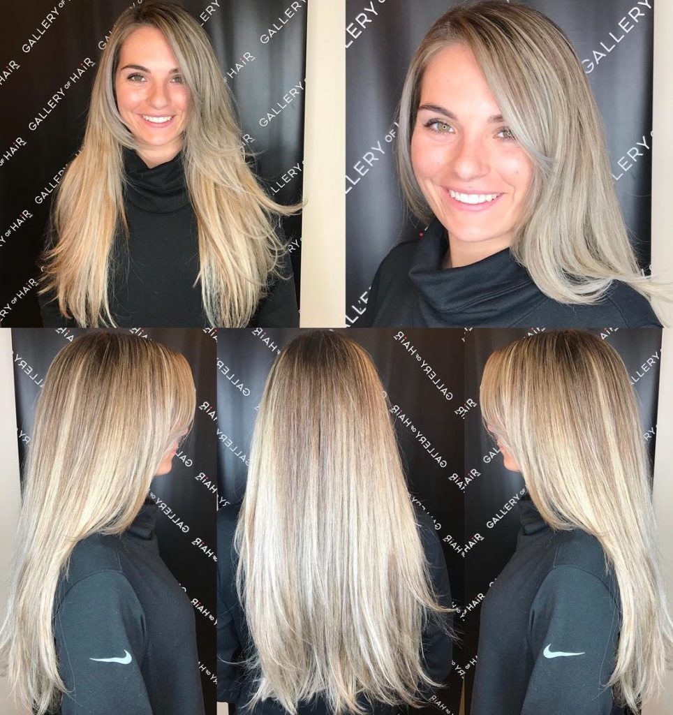 Layered Razor Cut Blowout with Long Side Swept Bangs and Blonde Color Melt Balayage Long Hairstyle