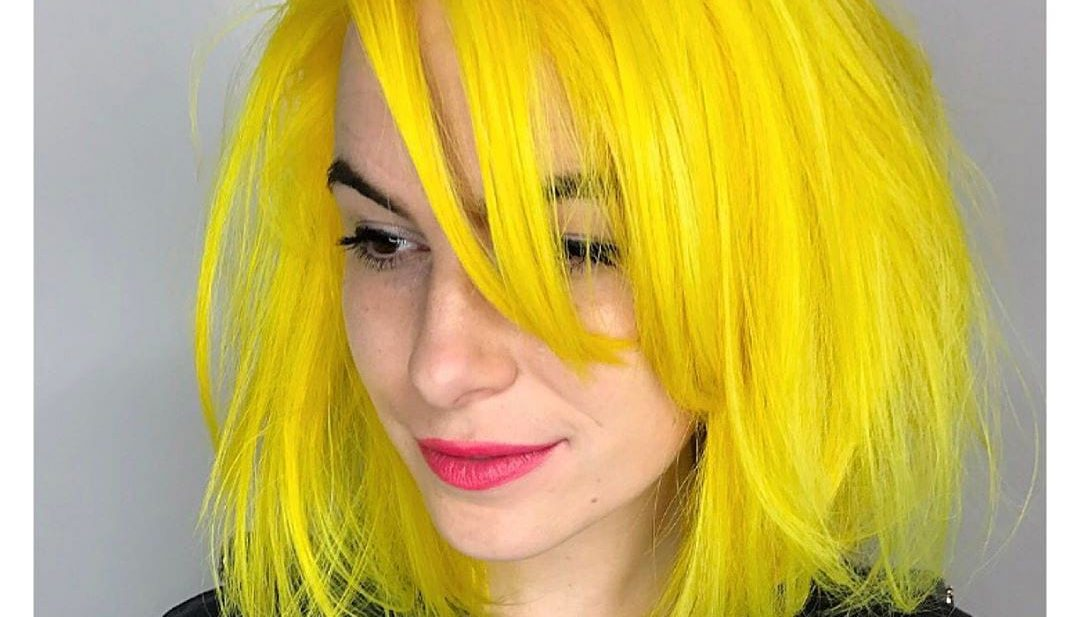 Layered Yellow Sunshine Lob with Undone Blowout Texture and Long Side Swept Bangs Medium Length Summer Hairstyle