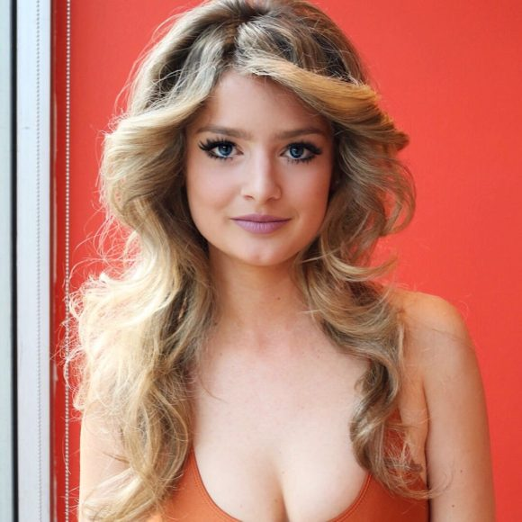 Long Blonde Feathered Layers Cut with Voluminous Undone Waves and Curtain Bangs Long Retro Farrah Fawcett Summer Hairstyle