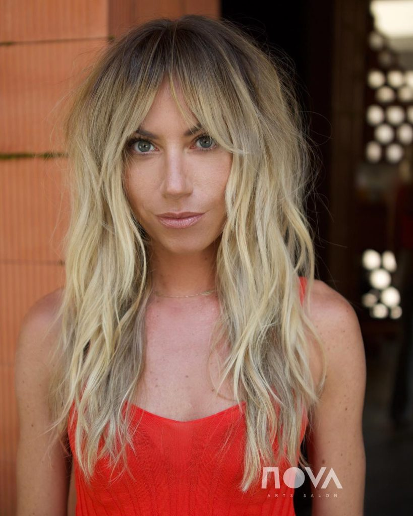 Long Bohemian Shag with Messy Textured Waves and Curtain Bangs on Sun Kissed Dirty Blonde Colored Hair Long Hairstyle
