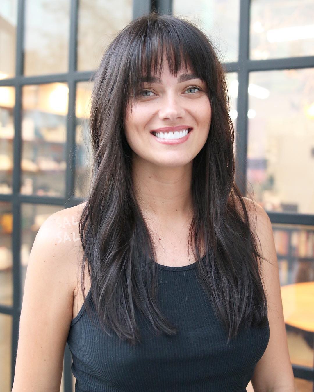 Long Brunette Fringe Cut with Bangs and Soft Messy Waves Long Hairstyle