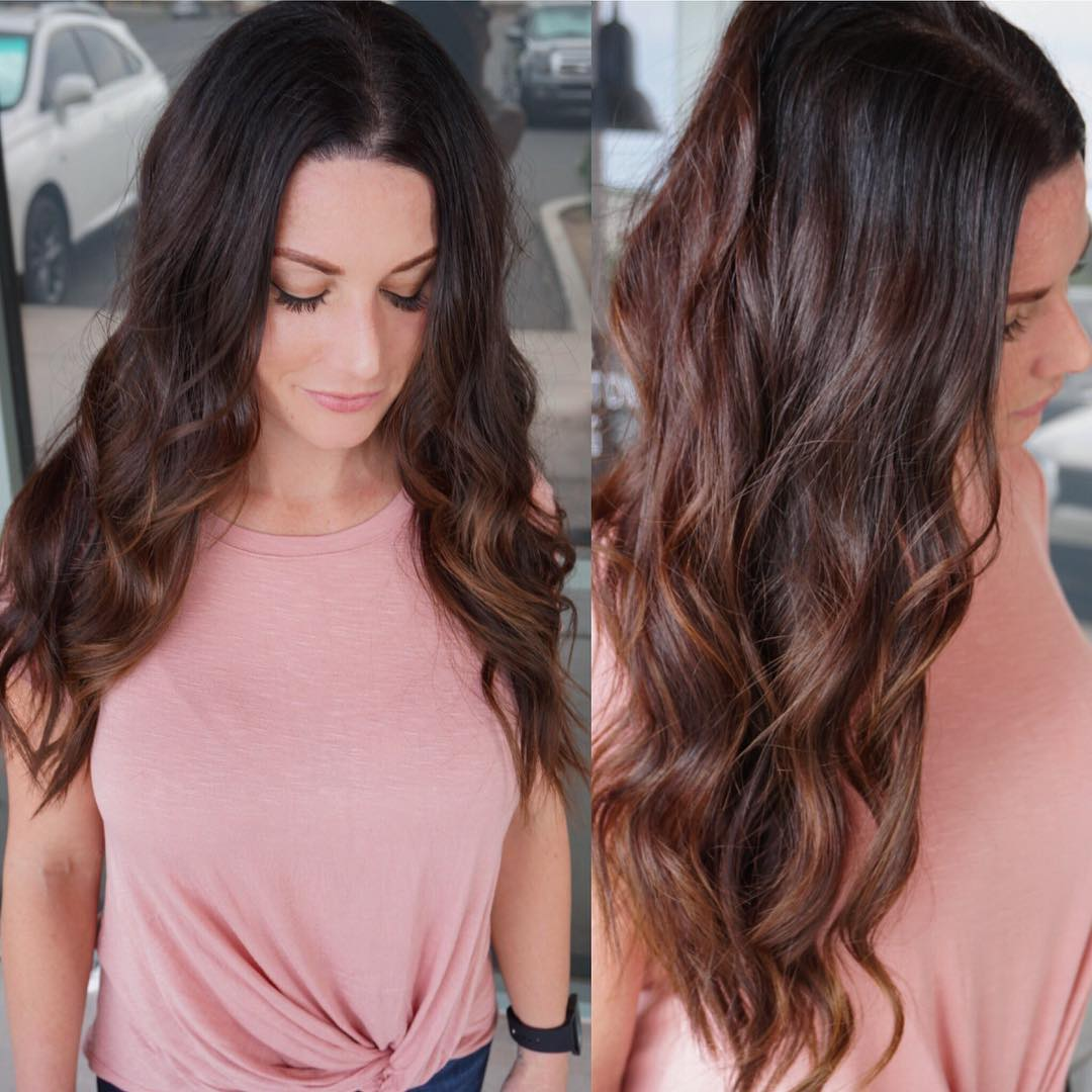 Long Brunette Wavy Layered Cut with Warm Toned Highlights Long Hairstyle