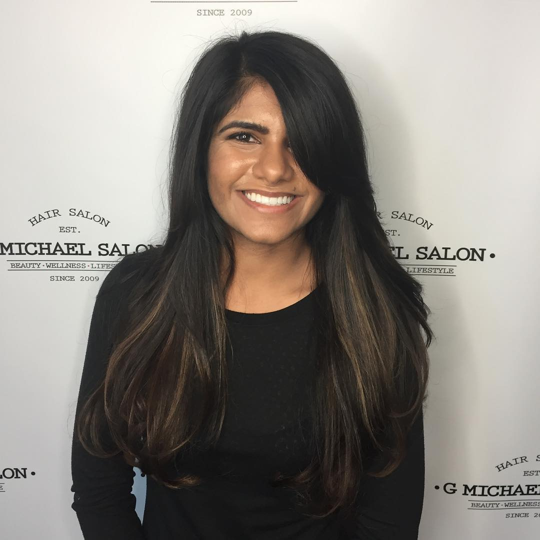 Long Dark Layered Cut with Side Swept Bangs and Balayage Coloring Long Hairstyle