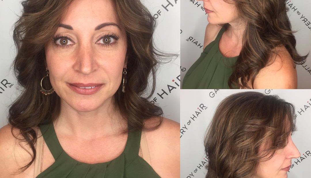 Long Layered Cut with Parted Bangs and Wavy Curls with Soft Brunette Balayage Long Hairstyle