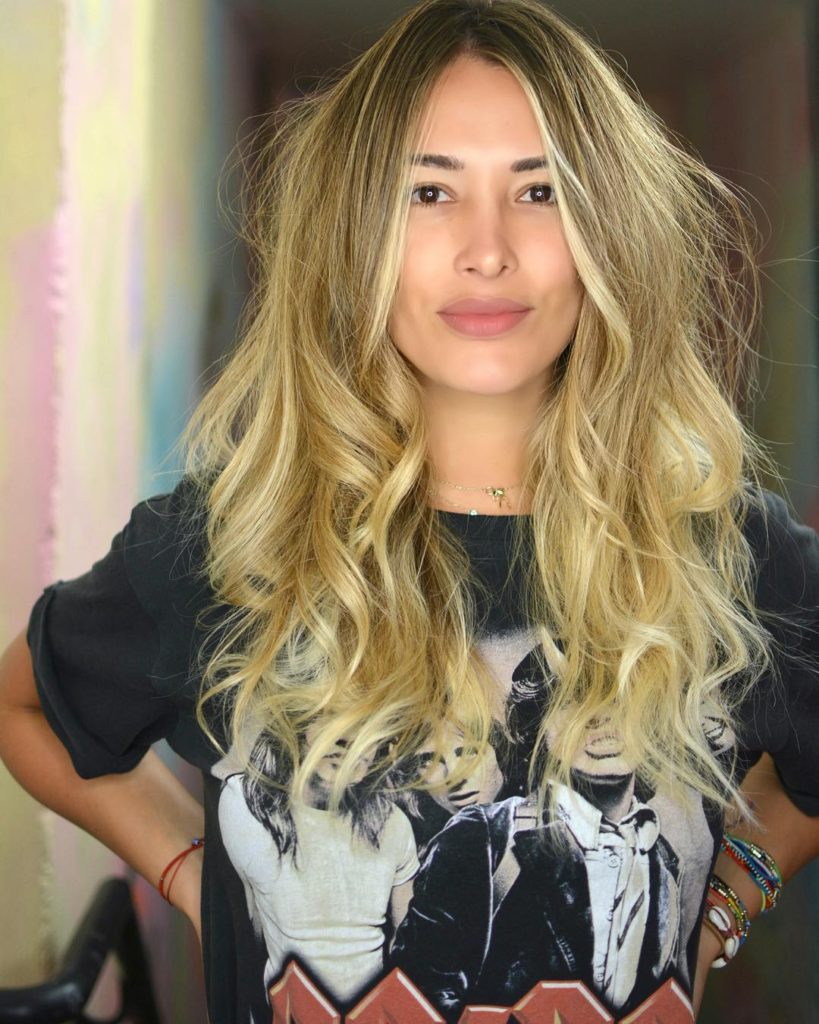 Long Layered Cut with Voluminous Messy Wavy Texture and Golden Blonde Balayage Color Trendy Fall Hairstyle