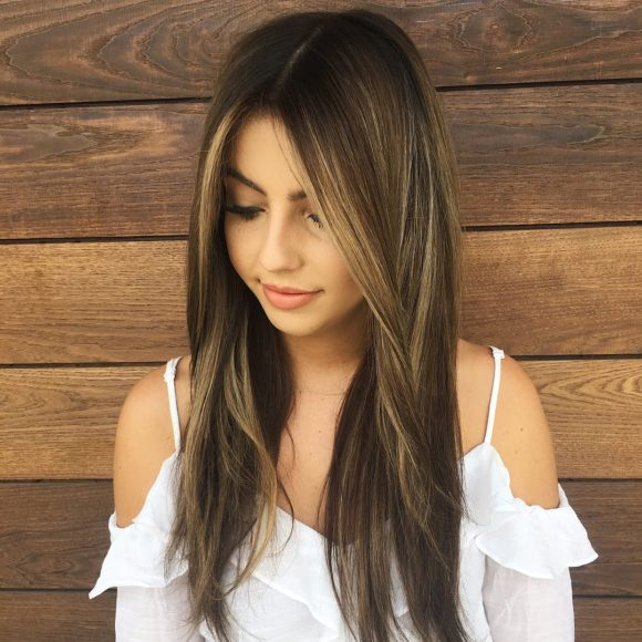 Long Messy Straight Textured Hair with Center Part and Brunette Reverse Balayage Color Long Summer Hairstyle
