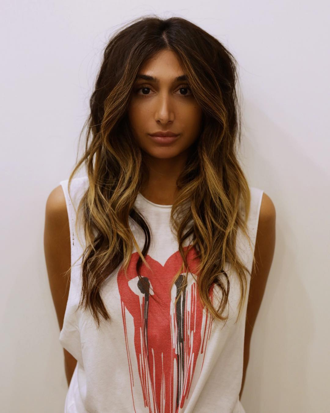 Long Parted Shag with Voluminous Messy Wavy Beach Texture and Bronzed Brunette Balayage Long Summer Hairstyle