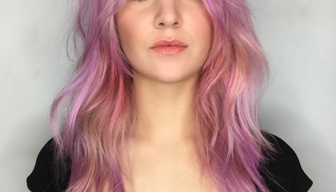 Long Pink Shag Cut with Messy Wavy Texture and Curtain Bangs Long Fall Hairstyle
