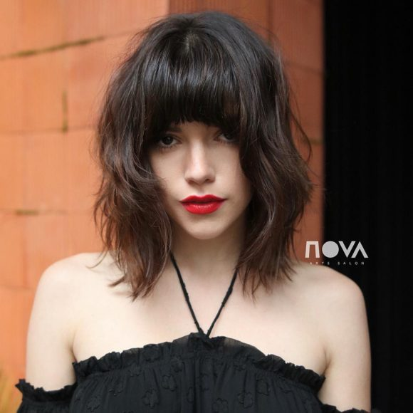 Long Shaggy Banged Bob with Messy Beach Texture and Soft Sun Kissed Brunette Balayage Medium Length Summer Hairstyle