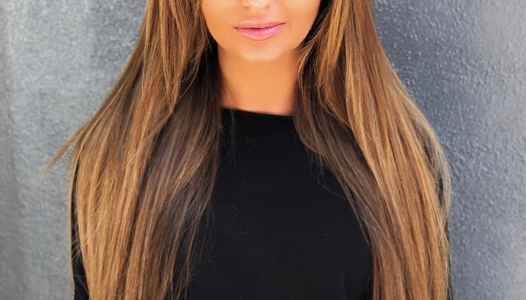 Soft Layered Cut with Straight Blowout Texture and Extensions on Honey Brown Balayage Colored Hair Long Hairstyle