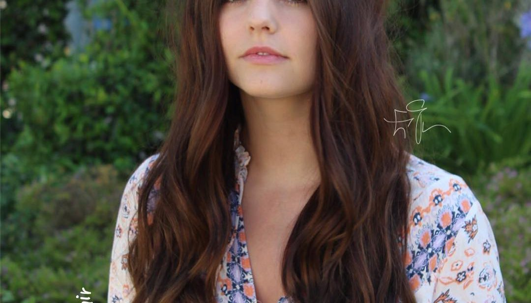 Long Warm Brunette Hair with Short Layers and Wavy Beach Texture Long Boho Chic Fall Hairstyle