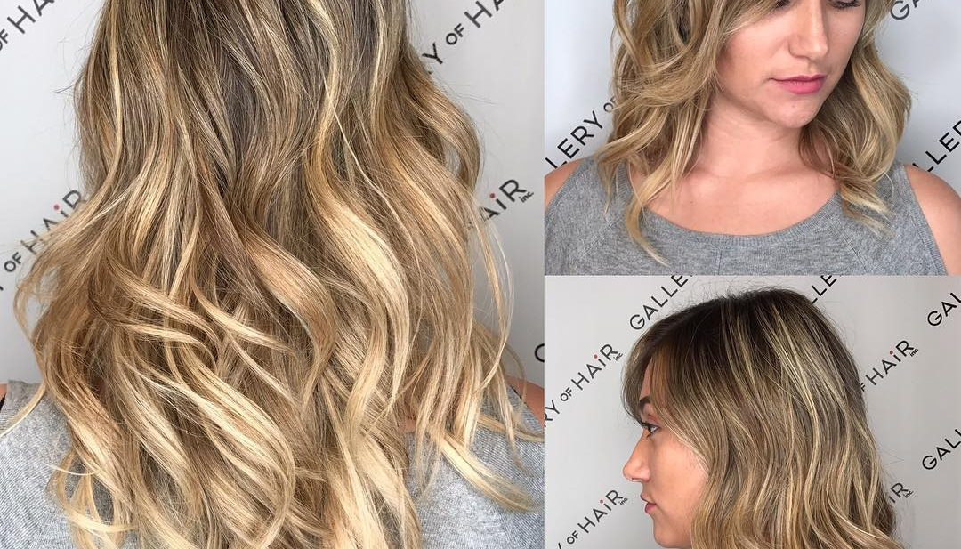 Long Wavy Layered Cut with Blonde Balayage Color Melt Long Hairstyle