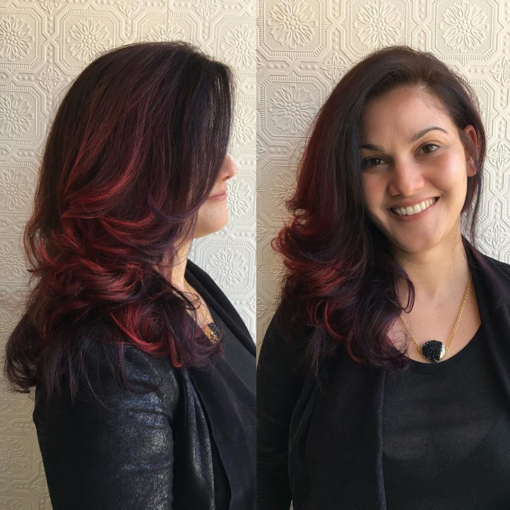 Long Blowout Layered Hair with Red Balayage Highlights