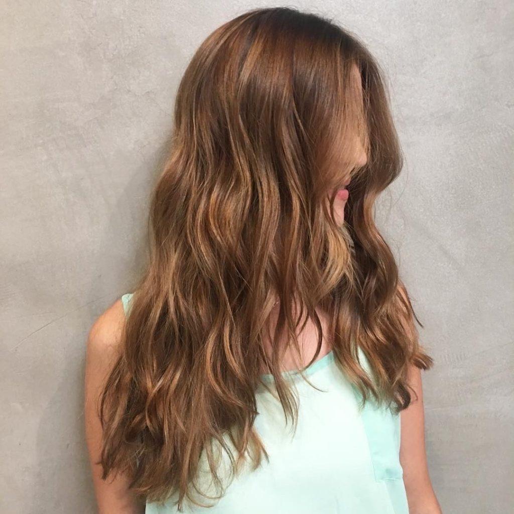 Long Wavy V-Cut Layers on Warm Light Brown Hair