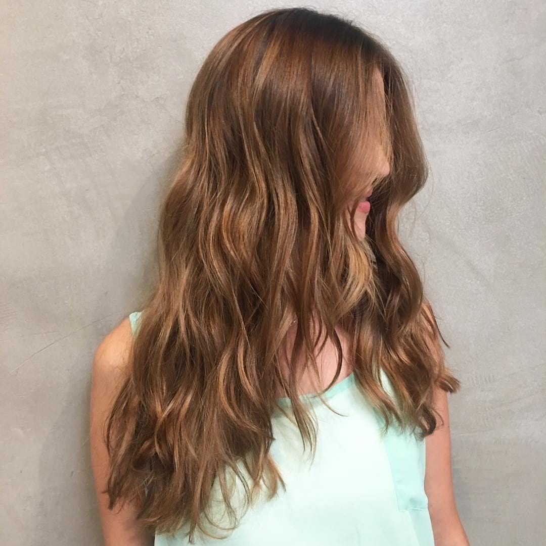Long Wavy V-Cut Layers on Warm Light Brown Hair