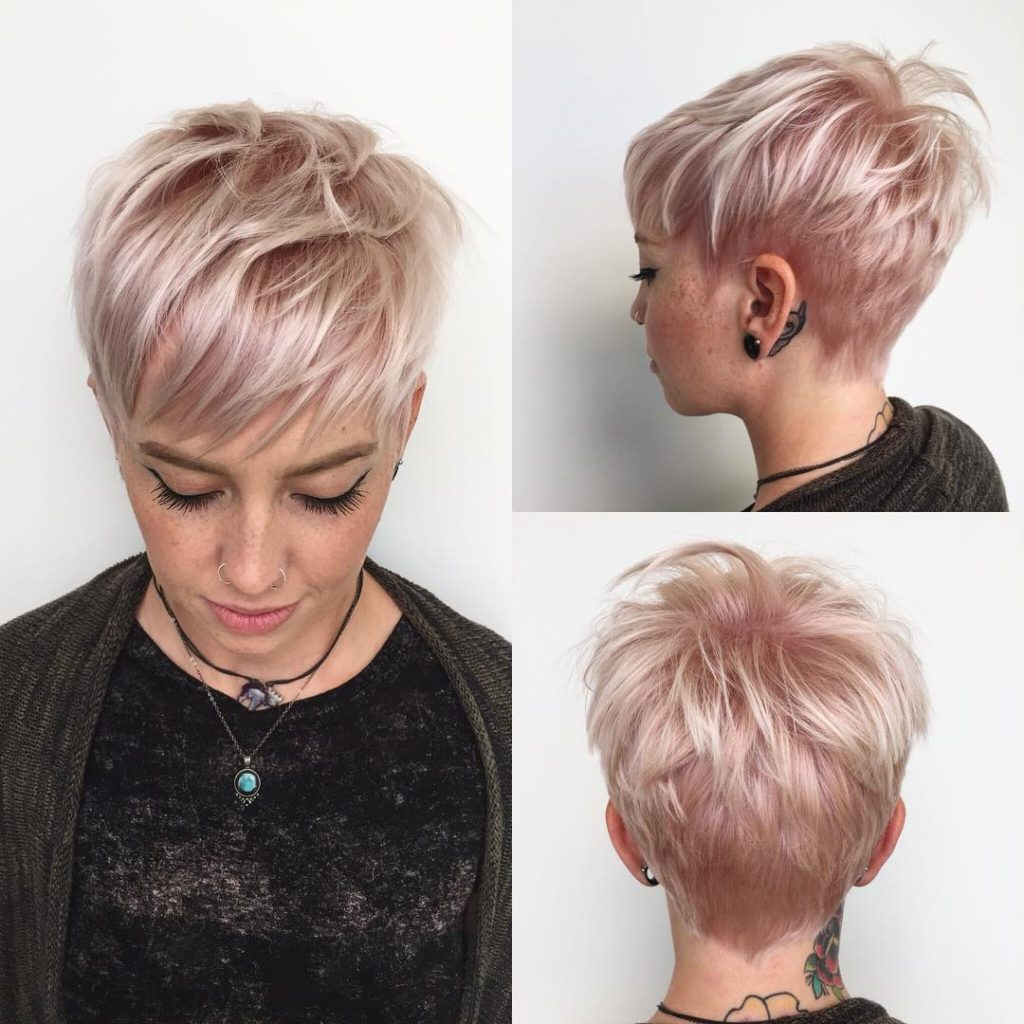 Messy Platinum Textured Pixie with Fringe Bangs and Soft Pink Highlights Short Hairstyle