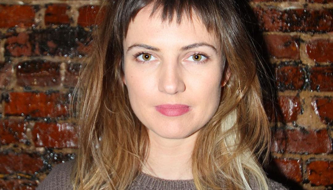 Messy Textured Micro Fringe Cut with Brunette Color Melt and Blonde Peek-a-Boo Highlights Medium Length Fall Hairstyle