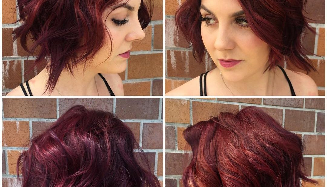Messy Waves on Angled Textured Bob with Face Framing Layers and Vivid Burgundy Color Short Hairstyle