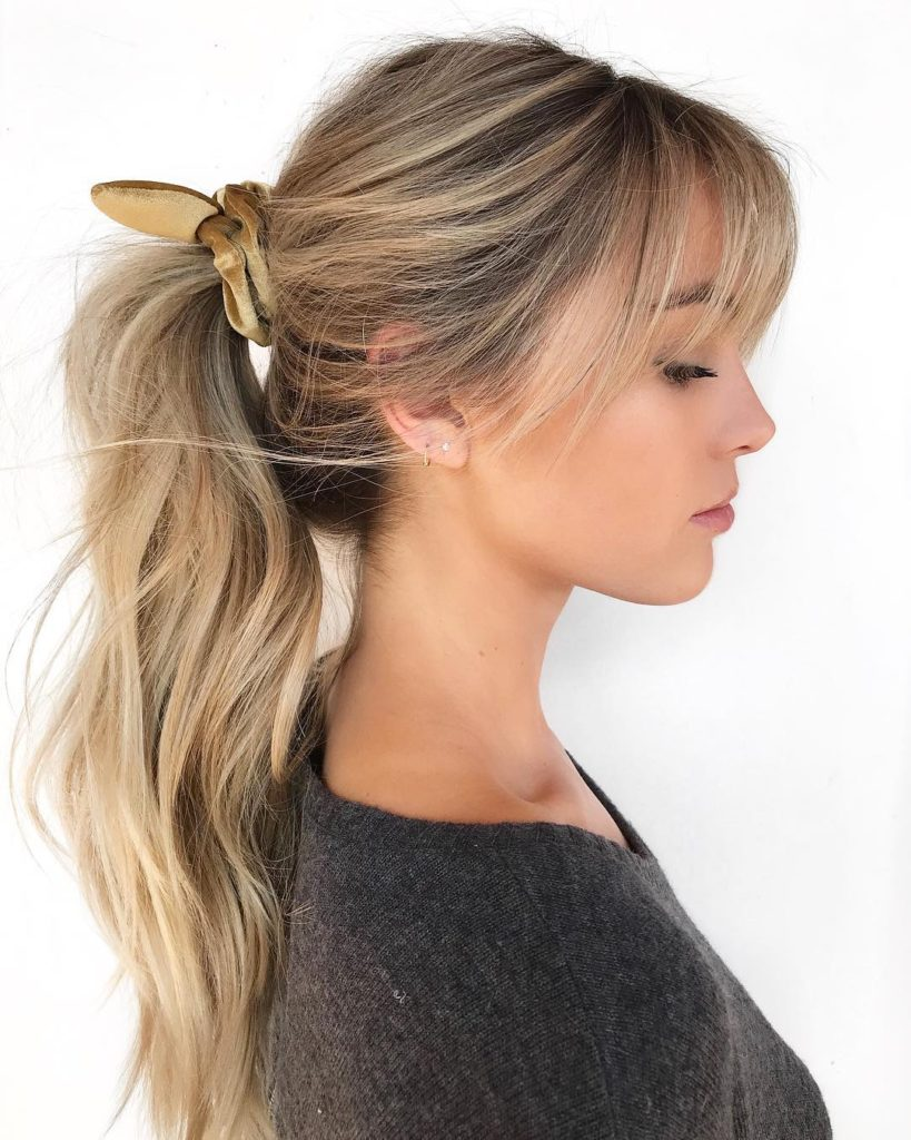 Messy Wavy Ponytail using Velvet Scrunchie with Fringe and Hand Painted Blonde Color Long Fall Updo Hairstyle