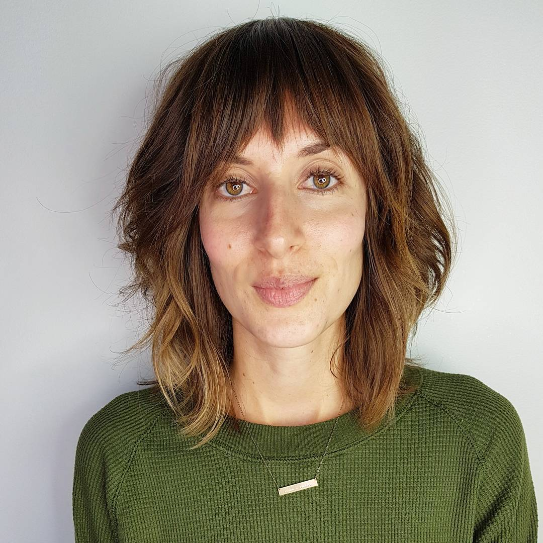 Modern Soft Wavy Shag Cut with Fringe Bangs and Sun Kissed Caramel Color Medium Length Hairstyle