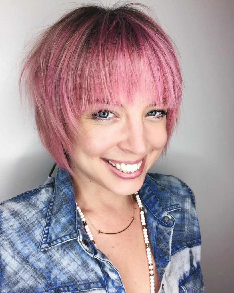 Pink Shaggy Bob with Feathered Bangs and Shadow Roots Short Hairstyle