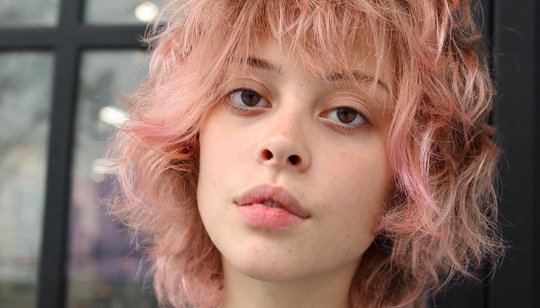 Pink Shaggy Face Framing Bob with messy Waves and Bangs Short Hairstyle