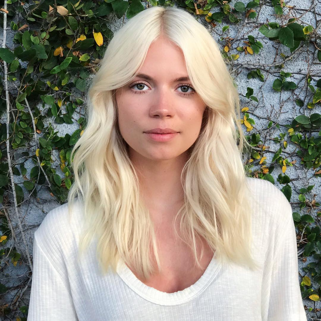 Platinum Blonde Layered Cut with Wavy Texture and Long Curtain Bangs Long Summer Hairstyle
