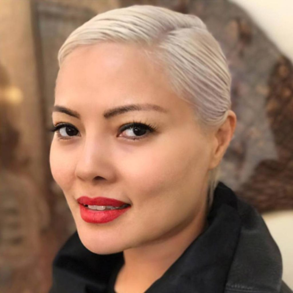 Platinum Blonde Pixie Crop with Slick Wet Side Swept Texture Short Fall Hairstyle