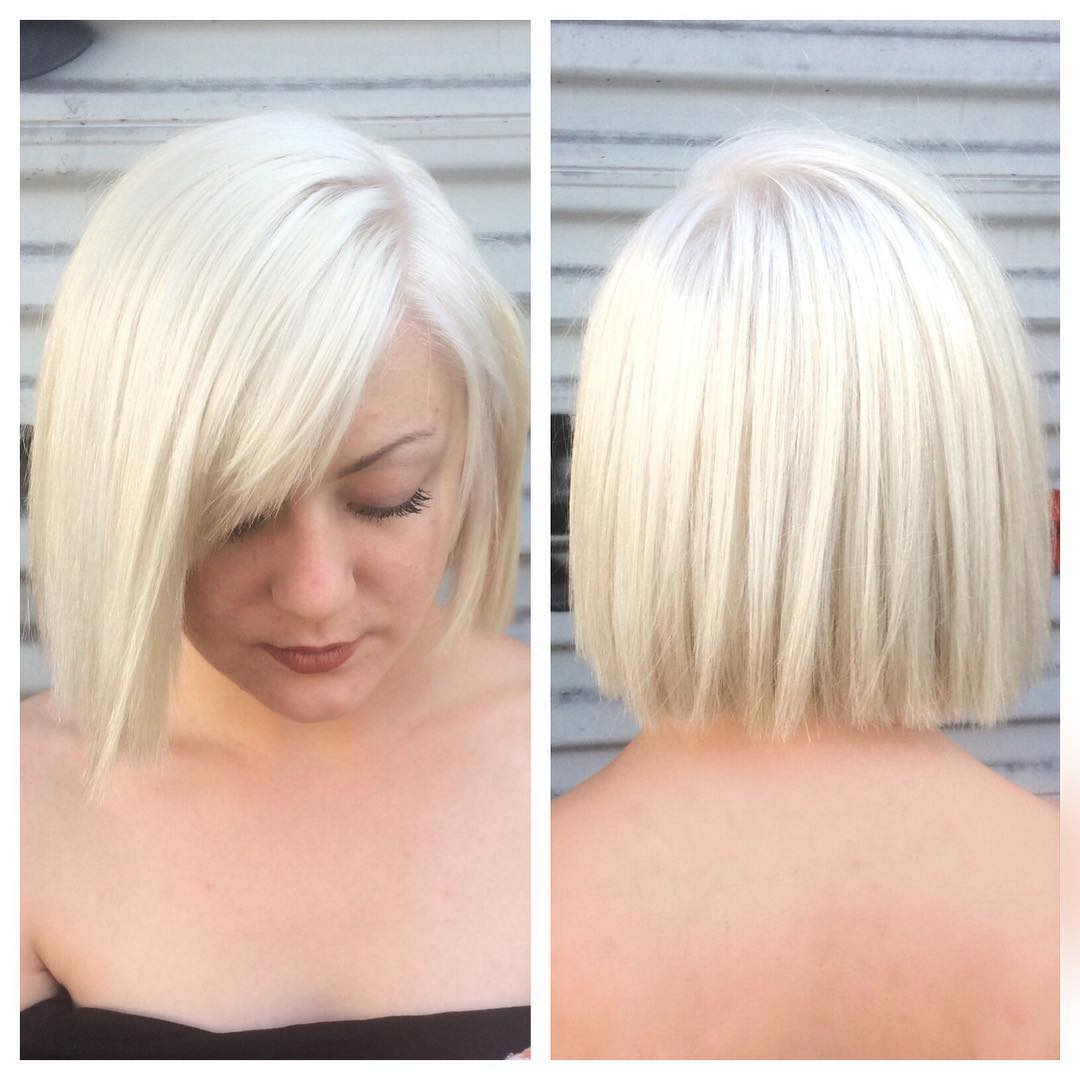 Platinum Blunt Cut Bob with Textured Ends and Side Swept Bangs Short Hairstyle