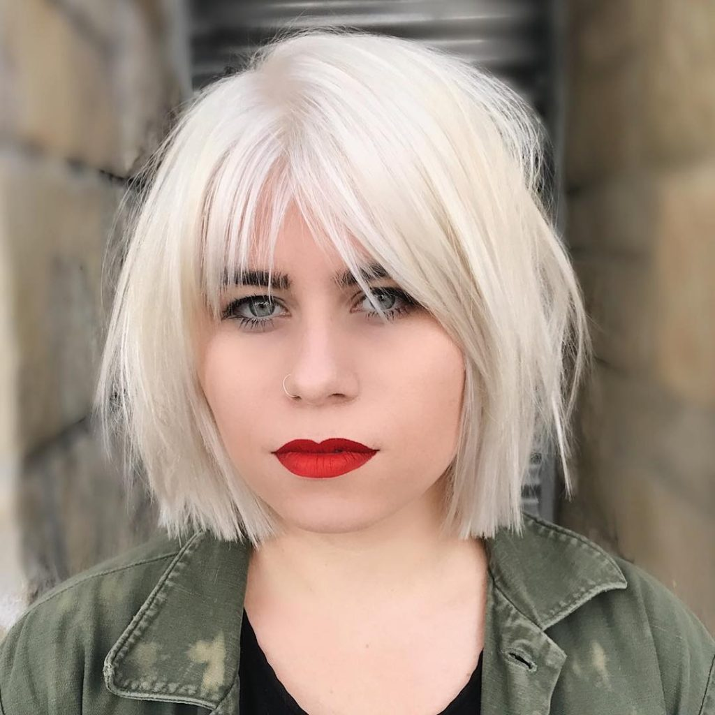 Platinum Choppy Bob with Parted Fringe Bangs and Undone Straight Texture Medium Length Hairstyle