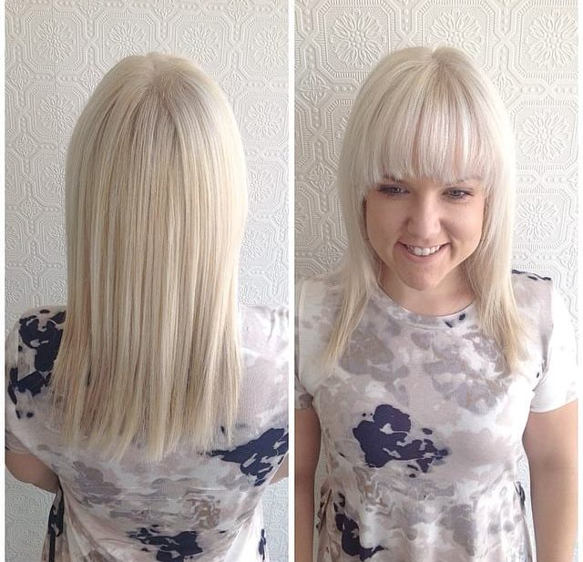 Platinum Face Framing Cut with Textured Ends and Full Brow Skimming Bangs Long Hairstyle