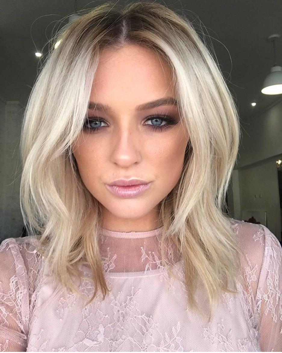 Platinum Soft Layered Lob with Parted Bangs and Undone Texture Medium Length Hairstyle