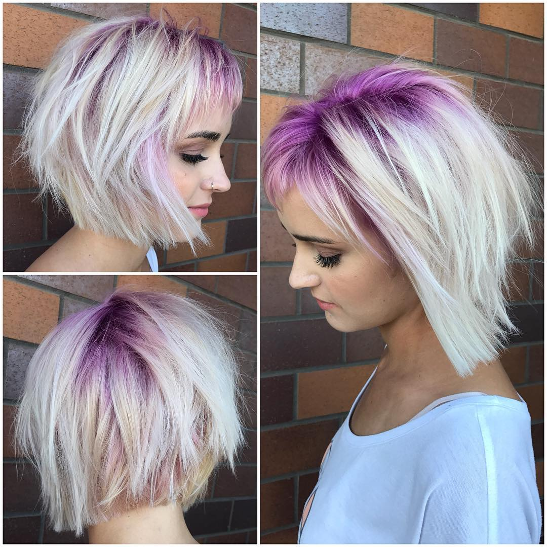 Platinum Stacked Bob with Choppy Bangs and Pink Shadow Roots Short Hairstyle